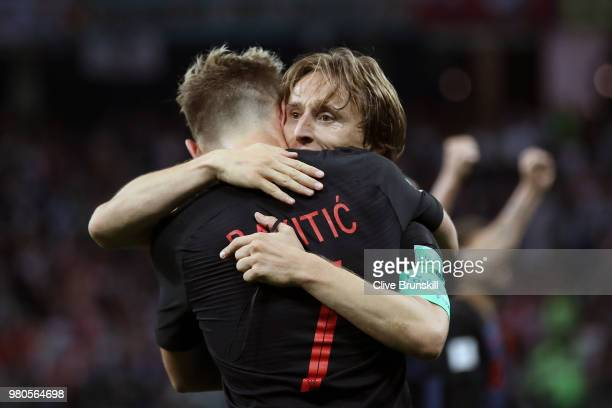 Ivan Rakitic of Croatia celebrates with teammate Luka Modric of Croatia after scoring his team's third goal during the 2018 FIFA World Cup Russia...
