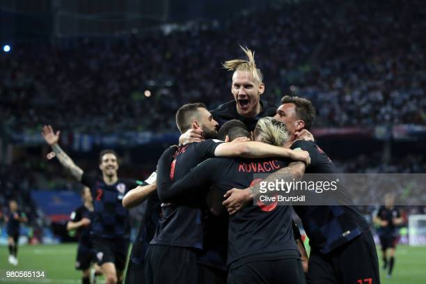 Ivan Rakitic of Croatia celebrates with teammates after scoring his team's third goal during the 2018 FIFA World Cup Russia group D match between...