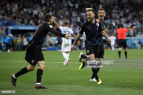 Ivan Rakitic of Croatia celebrates with teammates Mateo Kovacic and Mario Mandzukic of Croatia after scoring his team's third goal during the 2018...