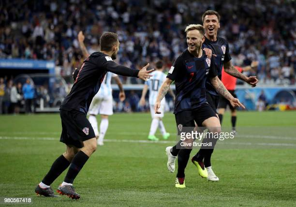 Ivan Rakitic of Croatia celebrates with teammates Mateo Kovacic and Mario Mandzukic of Croatia after scoring his team's third goal during the 2018...