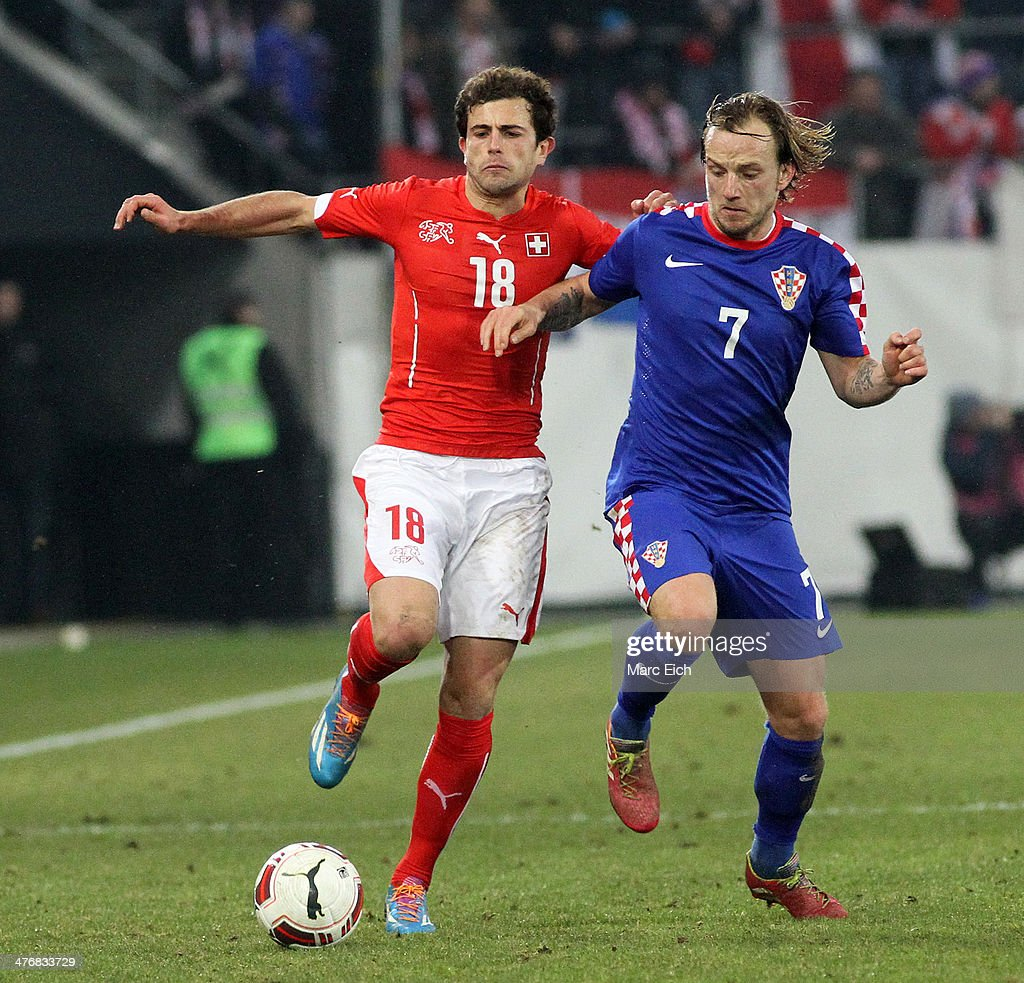 Ivan Rakitic of Croatia (R) challenges Admir Mehmedi of Switzerland (L) during the international friendly match between Switzerland and Croatia at the AFG Arena on March 5, 2014 in St Gallen, Switzerland.