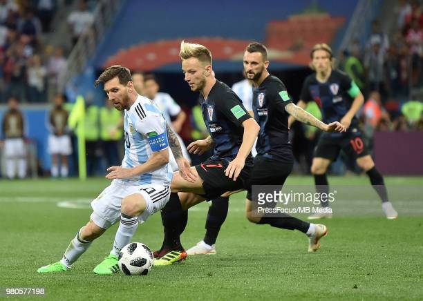 Ivan Rakitic of Croatia competes with Lionel Messi of Argentina during the 2018 FIFA World Cup Russia group D match between Argentina and Croatia at...