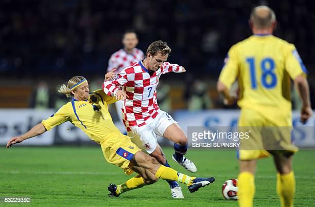 Ivan Rakitic of Croatia faights for a ball with Anatoliy Tymoshchuk of Ukraine during FIFA 2010 World Cup qualifying football match Ukraine vs...