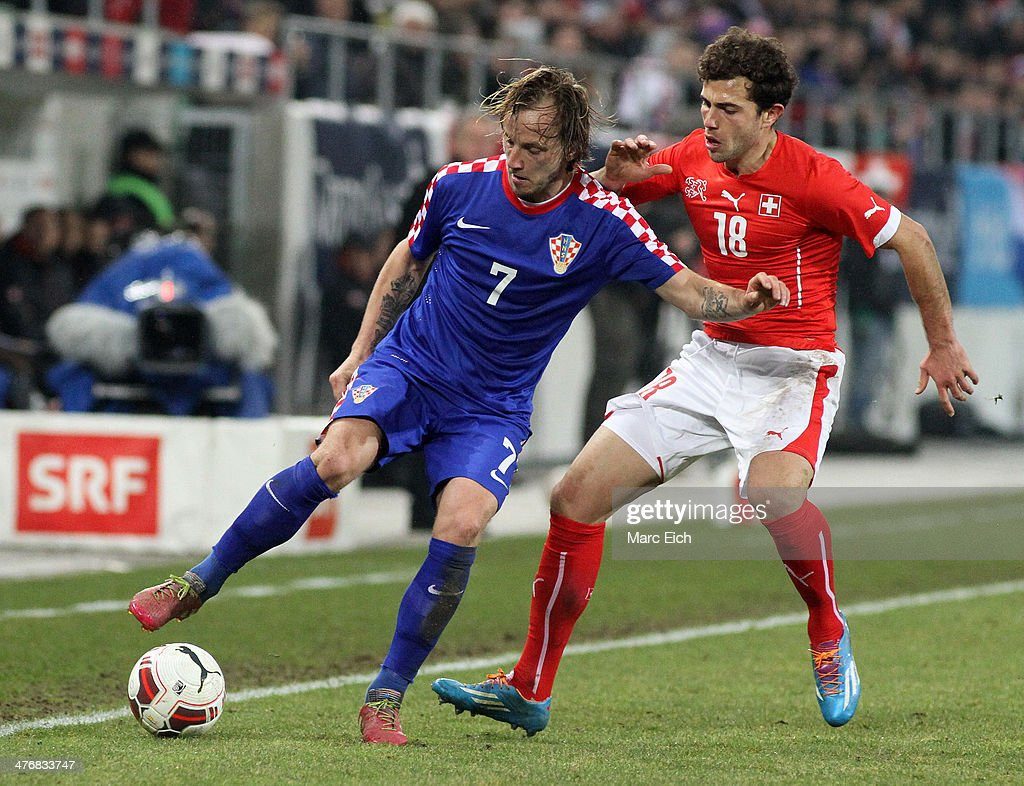 Ivan Rakitic of Croatia (L) is challenged by Admir Mehmedi of Switzerland (R) during the international friendly match between Switzerland and Croatia at the AFG Arena on March 5, 2014 in St Gallen, Switzerland.
