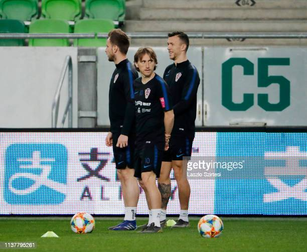 Ivan Rakitic of Croatia Luka Modric of Croatia and Ivan Perisic of Croatia attend a training session ahead of the UEFA EURO 2020 Qualifier match...