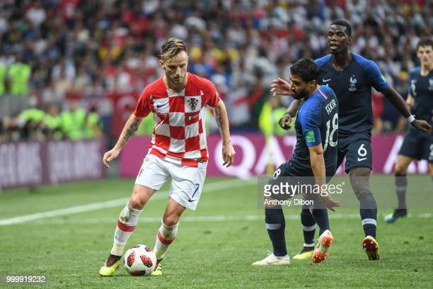 Ivan Rakitic of Croatia Nabil Fekir and Paul Pogba of France during the World Cup Final match between France and Croatia at Luzhniki Stadium on July...