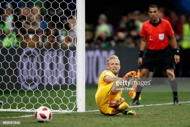 Ivan Rakitic of Croatia scores his team's fifth penalty in the penalty shoot out past Kasper Schmeichel of Denmark during the 2018 FIFA World Cup...