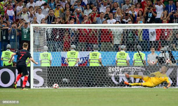 Ivan Rakitic of Croatia scores his team's fifthpenalty in the penalty shoot out past Kasper Schmeichel of Denmark during the 2018 FIFA World Cup...