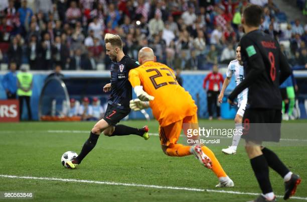 Ivan Rakitic of Croatia scores his team's third goal past Wilfredo Caballero of Argentina during the 2018 FIFA World Cup Russia group D match between...