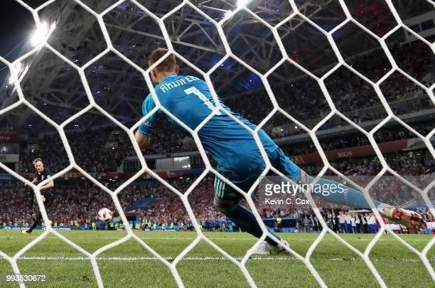 Ivan Rakitic of Croatia scores the fifth and the winning penalty past Igor Akinfeev of Russia in the penalty shoot out during the 2018 FIFA World Cup...