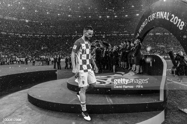 Ivan Rakitic of Croatia shows his dejection during the winners ceremony following France victory in the 2018 FIFA World Cup Russia Final between...