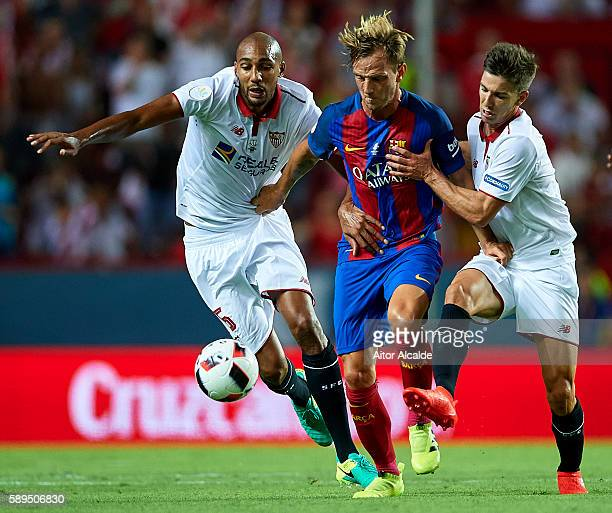 Ivan Rakitic of FC Barcelona being followed by Steven N'Zonzi of Sevilla FC and Luciano Vietto of Sevilla FC during the match between Sevilla FC vs...