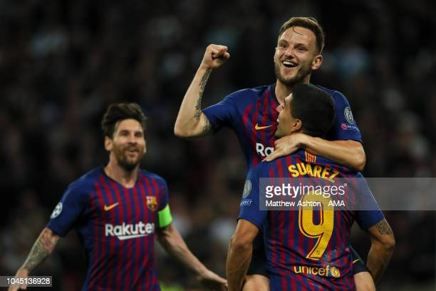 Ivan Rakitic of FC Barcelona celebrates after scoring a goal to make it 02 during the Group B match of the UEFA Champions League between Tottenham...