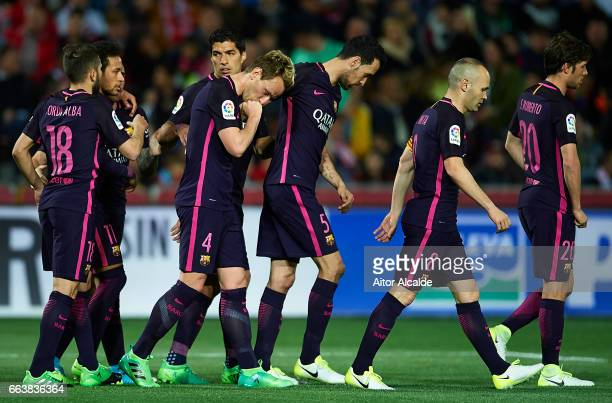 Ivan Rakitic of FC Barcelona celebrates after scoring during the La Liga match between Granada CF v FC Barcelona at Estadio Nuevo Los Carmenes on...