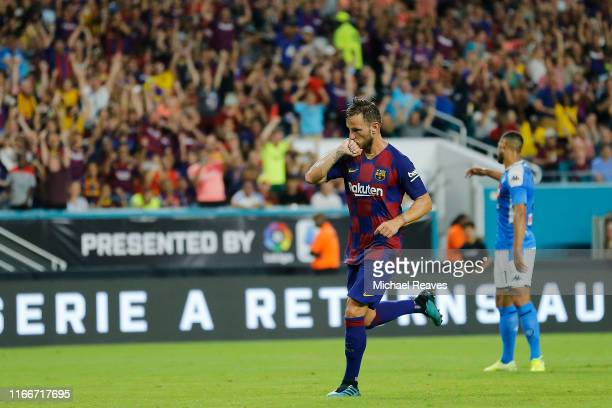 Ivan Rakitic of FC Barcelona celebrates after scoring the second goal of his team against SSC Napoli during the second half of a preseason friendly...