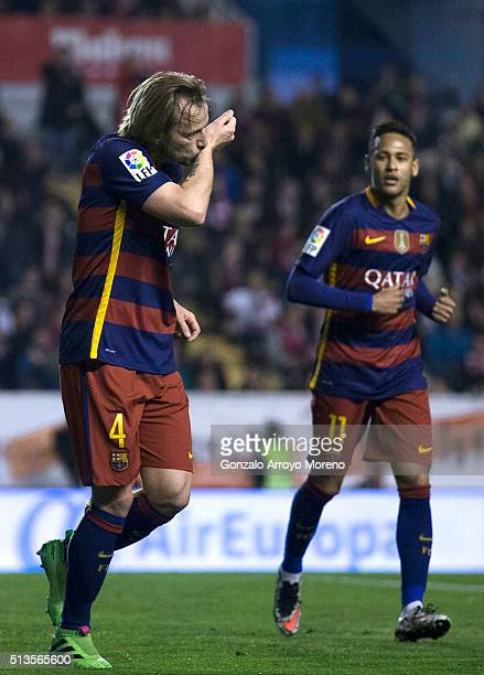 Ivan Rakitic of FC Barcelona celebrates scoring their opening goal during the La Liga match between Rayo Vallecano de Madrid and FC Barcelona at...
