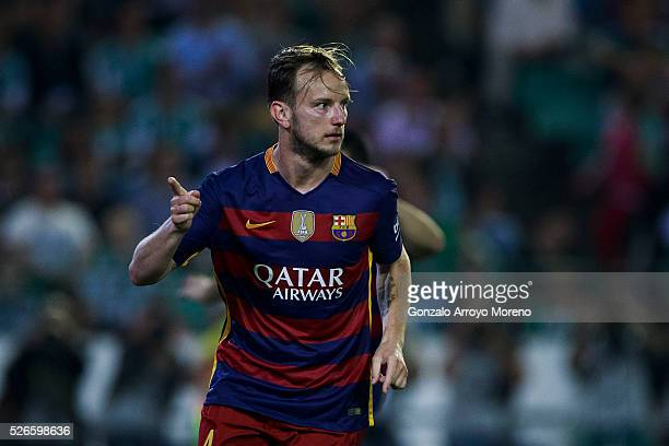 Ivan Rakitic of FC Barcelona celebrates scoring their opening goal during the La Liga match between Real Betis Balompie and FC Barcelona at Estadio...