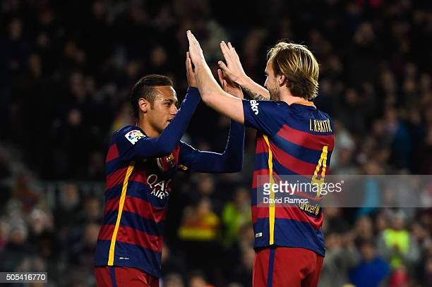 Ivan Rakitic of FC Barcelona celebrates with his teammate after scoring his team's fourth goal during the La Liga match between FC Barcelona and...