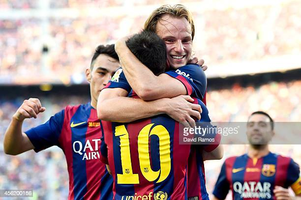 Ivan Rakitic of FC Barcelona celebrates with his teammate Lionel Messi of FC Barcelona after scoring his team's second goal during the La Liga match...