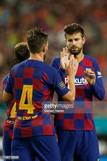 Ivan Rakitic of FC Barcelona celebrates with teammate Gerard Pique after scoring the second goal of his team against SSC Napoli during the second...