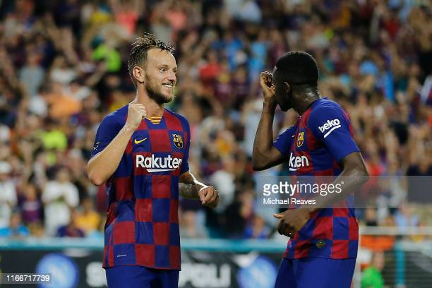 Ivan Rakitic of FC Barcelona celebrates with teammate Ousmane Dembele after scoring the goal of his team against SSC Napoli during the second half of...