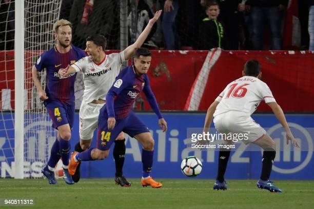 Ivan Rakitic of FC Barcelona Clement Lenglet of Sevilla FC claims a penalty Philippe Coutinho of FC Barcelona Jesus Navas of Sevilla FC during the La...