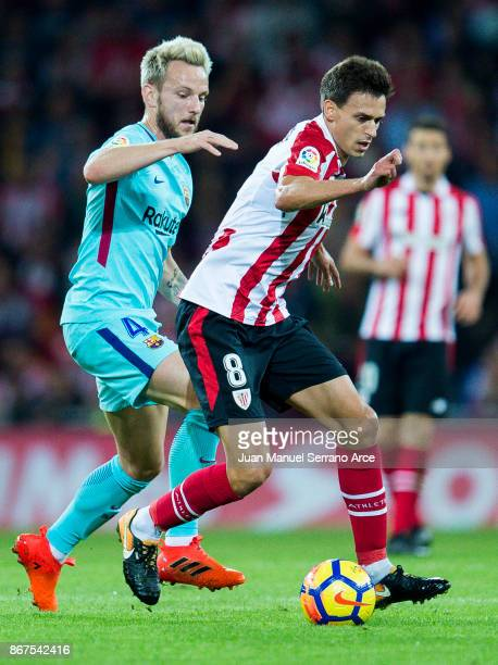 Ivan Rakitic of FC Barcelona competes for the ball with Ander Iturraspe of Athletic Club during the La Liga match between Athletic Club Bilbao and FC...