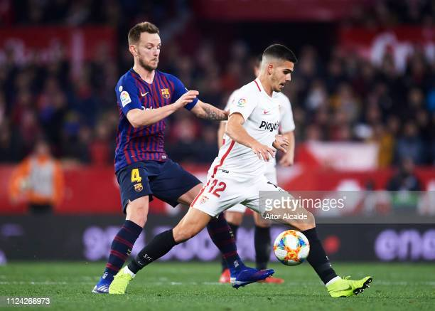 Ivan Rakitic of FC Barcelona competes for the ball with Andre Silva of Sevilla FC during the Copa del Quarter Final match between Sevilla FC and FC...