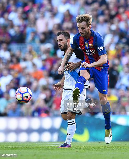 Ivan Rakitic of FC Barcelona competes for the ball with Emre Colak of RC Deportivo La Coruna during the La Liga match between FC Barcelona and RC...