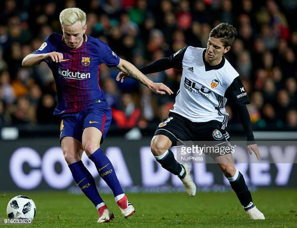 Ivan Rakitic of FC Barcelona competes for the ball with Vietto of Valencia CF during the Copa del Rey semifinal second leg match between Valencia CF...