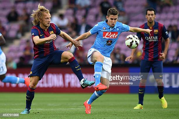 Ivan Rakitic of FC Barcelona competes with Jorginho of SSC Napoli during the preseason friendly match between FC Barcelona and SSC Napoli on August 6...