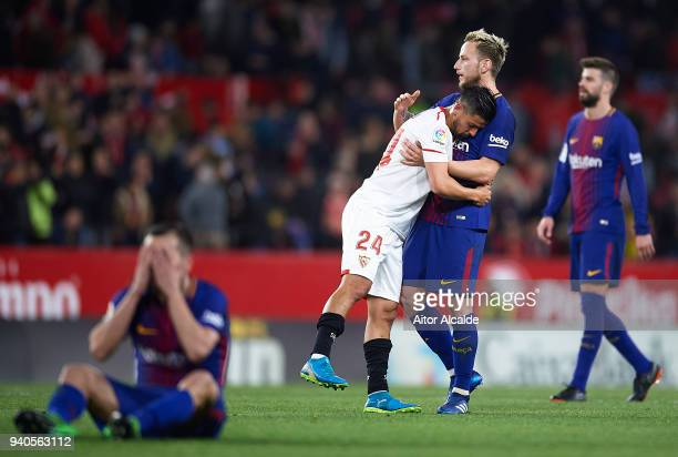 Ivan Rakitic of FC Barcelona consolates Manuel Agudo Nolito of Sevilla Fof Sevilla FC during the La Liga match between Sevilla CF and FC Barcelona at...