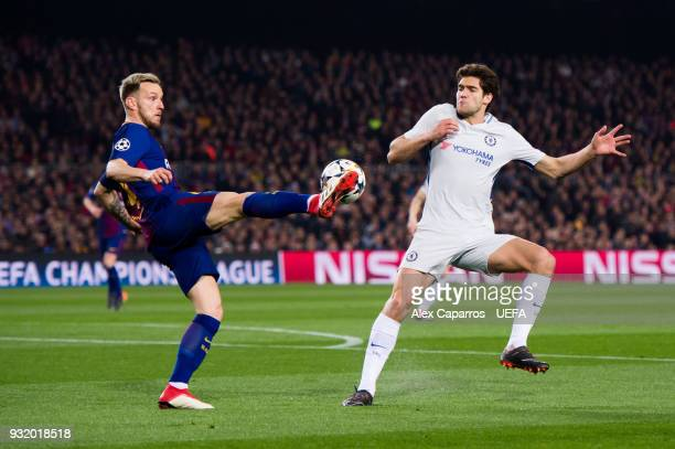 Ivan Rakitic of FC Barcelona controls the ball next to Marcos Alonso of Chelsea FC during the UEFA Champions League Round of 16 Second Leg match...