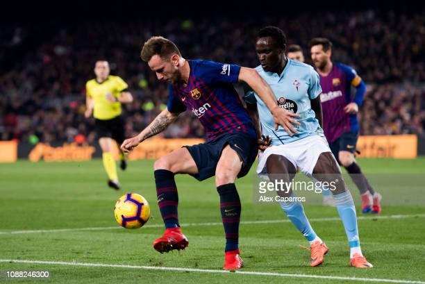 Ivan Rakitic of FC Barcelona controls the ball under pressure from Pione Sisto of RC Celta de Vigo during the La Liga match between FC Barcelona and...