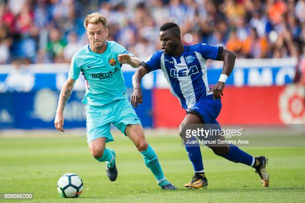 Ivan Rakitic of FC Barcelona duels for the ball with Wakaso Mubarak of Deportivo Alaves during the La Liga match between Deportivo Alaves and...