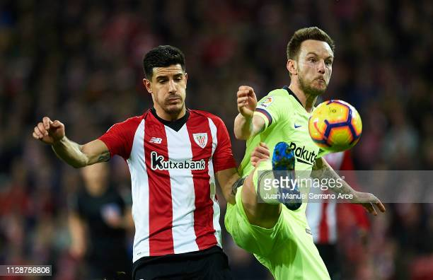 Ivan Rakitic of FC Barcelona duels for the ball with Yuri Berchiche of Athletic Club during the La Liga match between Athletic Club and FC Barcelona...
