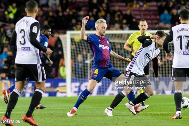 Ivan Rakitic of FC Barcelona fights for the ball with Luciano Vietto of Valencia CF during the Copa Del Rey 201718 match between FC Barcelona and...