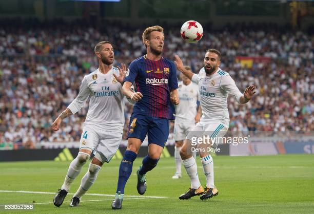 Ivan Rakitic of FC Barcelona goes for the ball against Serio Ramos of Real Madrid CF during the Supercopa de Espana Final 2nd Leg match between Real...