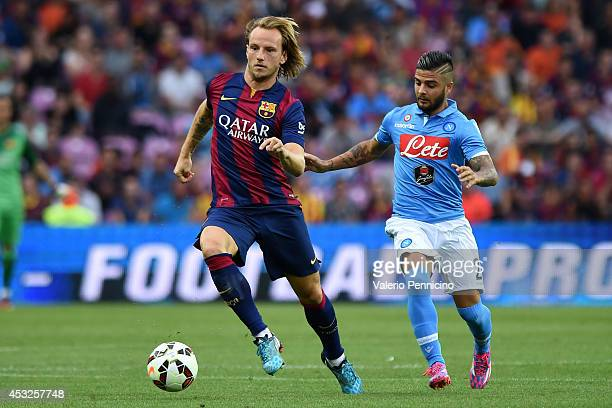 Ivan Rakitic of FC Barcelona in action against Lorenzo Insigne of SSC Napoli during the preseason friendly match between FC Barcelona and SSC Napoli...