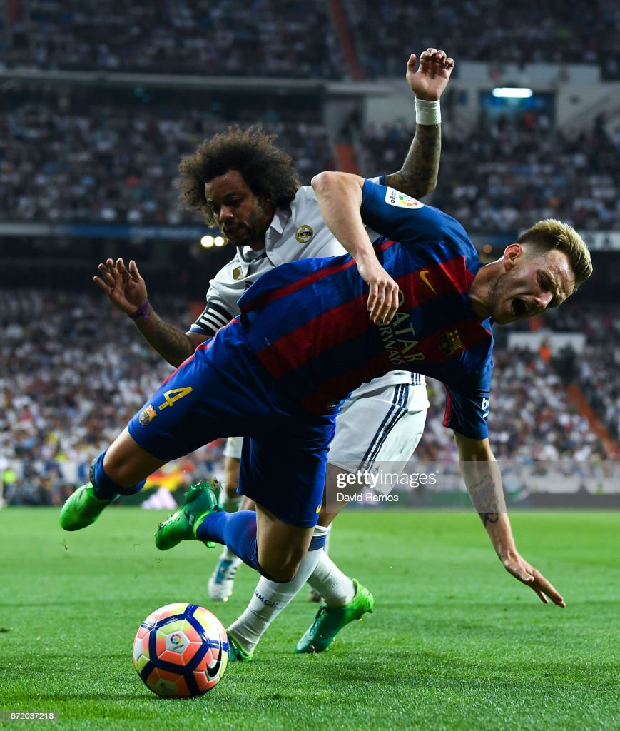 Ivan Rakitic of FC Barcelona is brought down by Marcelo Vieira of Real Madrid CF during the La Liga match between Real Madrid CF and FC Barcelona at the Santiago Bernabeu stadium on April 23, 2017 in Madrid, Spain.