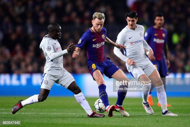 Ivan Rakitic of FC Barcelona is challenged by N'Golo Kante and Alvaro Morata both of Chelsea during the UEFA Champions League Round of 16 Second Leg...