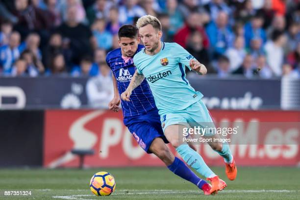 Ivan Rakitic of FC Barcelona is tackled by Gabriel Appelt Pires of CD Leganes during the La Liga 201718 match between CD Leganes vs FC Barcelona at...