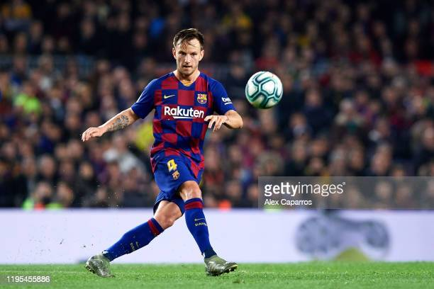 Ivan Rakitic of FC Barcelona plays the ball during the Liga match between FC Barcelona and Real Madrid CF at Camp Nou on December 18 2019 in...
