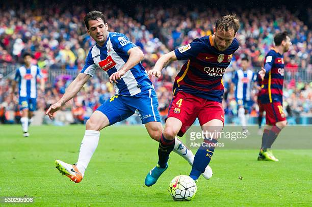 Ivan Rakitic of FC Barcelona protects the ball from Victor Sanchez of RCD Espanyol during the La Liga match between FC Barcelona and RCD Espanyol at...