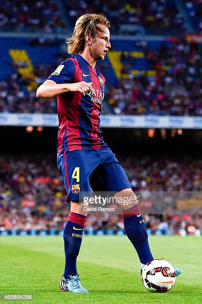 Ivan Rakitic of FC Barcelona runs with the ball during the Joan Gamper Trophy match between FC Barcelona and Club Leon at Camp Nou on August 18 2014...