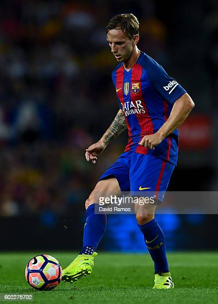 Ivan Rakitic of FC Barcelona runs with the ball during the La Liga match between FC Barcelona and Deportivo Alaves at Camp Nou stadium on September...
