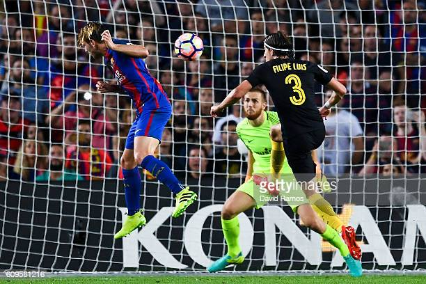 Ivan Rakitic of FC Barcelona scores the opening goal past Filipe Luis and the goalkeeper Jan Oblak of Club Atletico de Madrid during the La Liga...