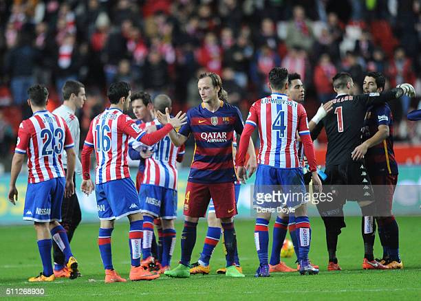Ivan Rakitic of FC Barcelona shakes hands with Carlos Castro of Sporting Gijon at the end of the La Liga match between Sporting Gijon and FC...