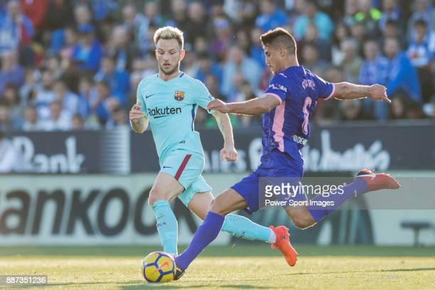 Ivan Rakitic of FC Barcelona tackles Gabriel Appelt Pires of CD Leganes during the La Liga 201718 match between CD Leganes vs FC Barcelona at Estadio...