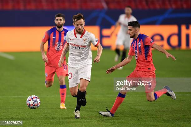 Ivan Rakitic of FC Sevilla looks to break past Jorginho of Chelsea during the UEFA Champions League Group E stage match between FC Sevilla and...